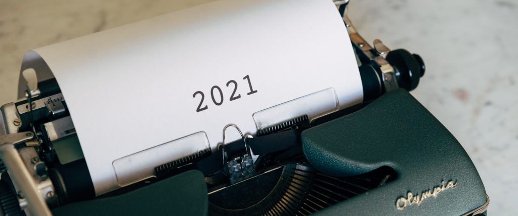 Typewriter with 2021 typed on paper